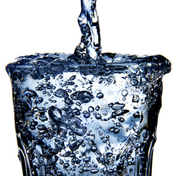 Closeup of a refreshing glass of water on a white background