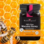 A picture of 100% Raw Wedderspoon Manuka Honey on a background of bees in honeycomb.