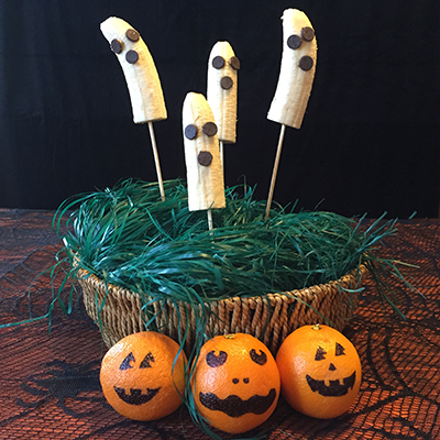 banana_ghosts_orange_jack_o_lanterns