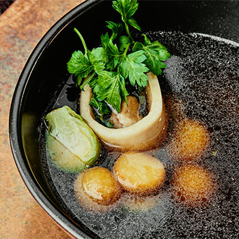Picture of beef bone broth in a pot.