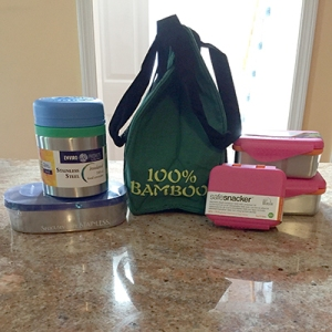 Picture of safe stainless steel lunch containers, insulated container, and bamboo lunch bag from New Wave Enviro.